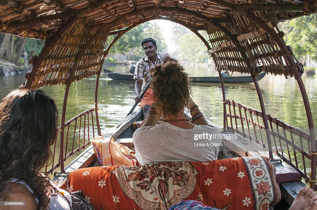 A couple on a guided boat ride in India.