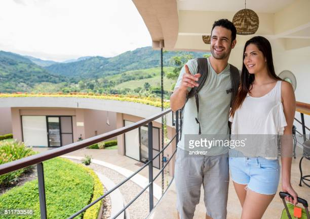 Couple on a romantic getaway looking at the view of their hotel