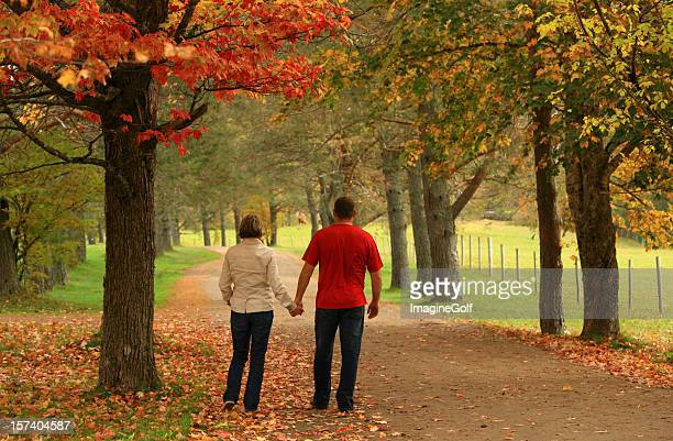 Couple on a Romantic Walk Down Rural Road in Fall
