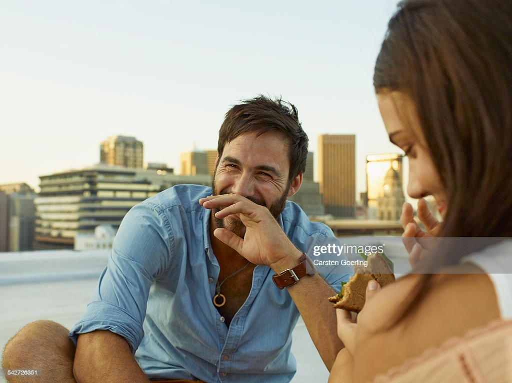 Couple on a rooftop : Stock Photo