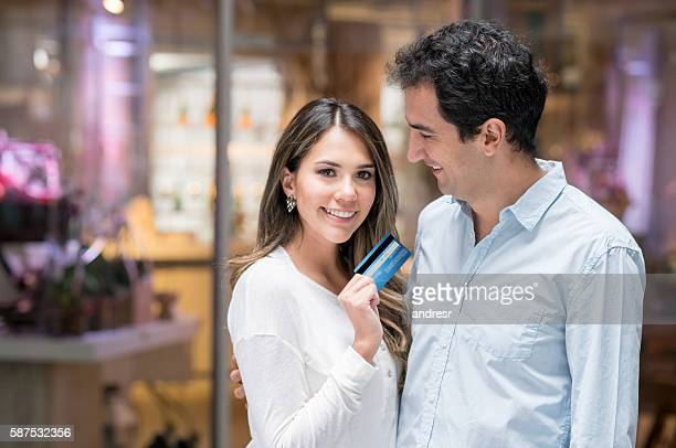 Couple on a shopping spree with a credit card