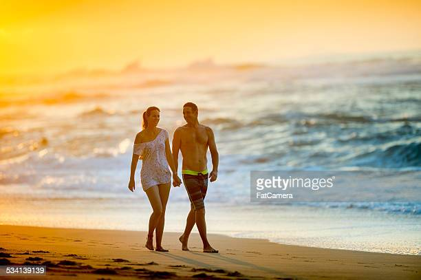 Couple on a tropical beach vacation to Hawaii for honeymoon