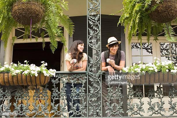 Couple on balcony in New Orleans, Louisiana