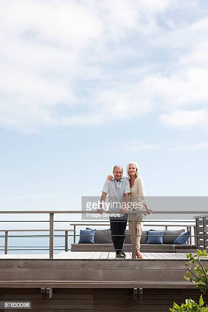 Couple on balcony of beach house