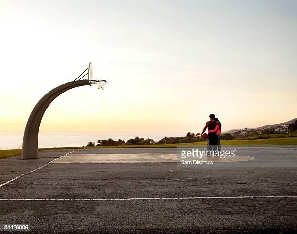 Couple On Basket Ball Court