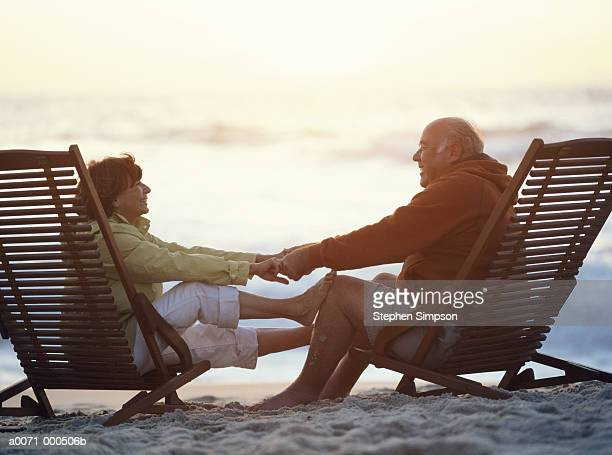 Couple on Beach at SunsetEndingsBeginningsRelaxationRomanceLoveTogetherness