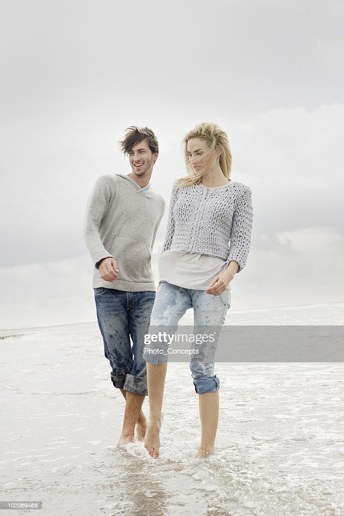 Couple on beach in autumn