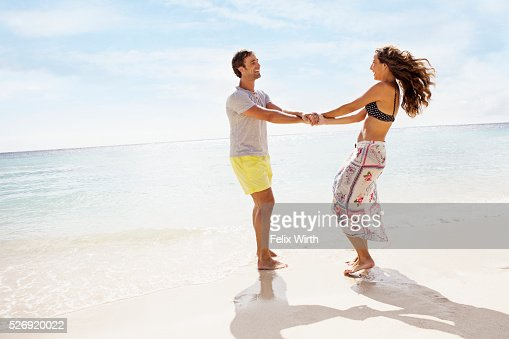 Couple on beach on summer day : Stock-Foto