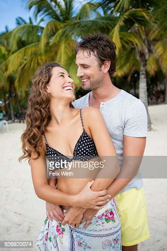 Couple on beach on summer day : Bildbanksbilder