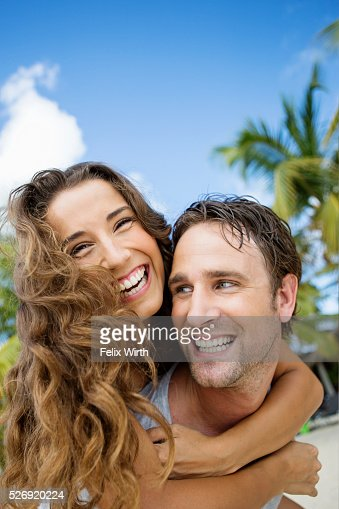 Couple on beach on summer day : Stockfoto