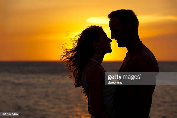Couple on beach sunset silhouette
