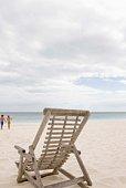 Couple on beach with chair
