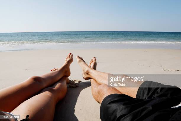 Couple on beach with legs