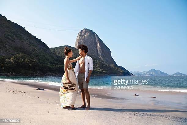 Couple on beach with radio, Rio de Janeiro, Brazil