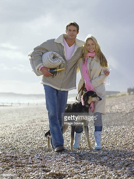 Couple on beach with their dog