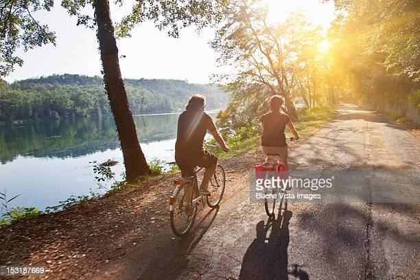 couple on bicycle along a river