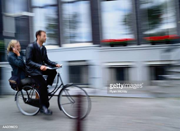 Couple on Bicycle, Woman on Cellular Phone