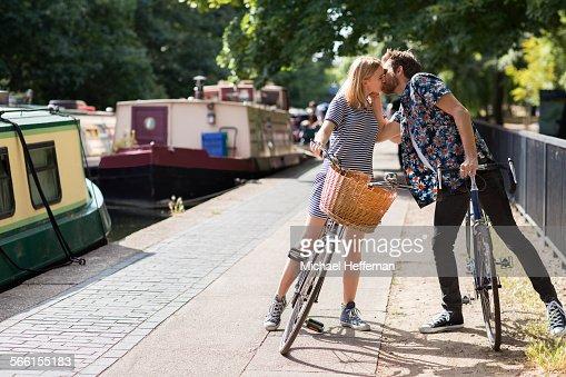 Couple on bikes kissing