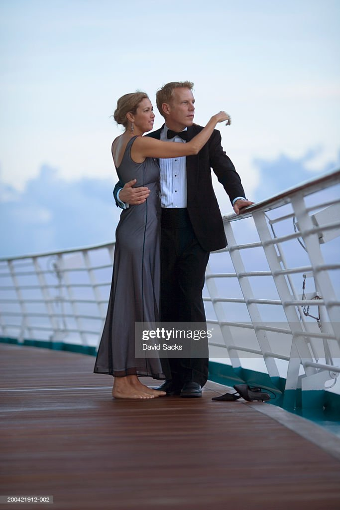 Couple On Cruise Ship Looking At Ocean Stock Photo