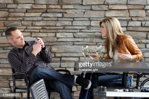 Couple on Date Guy Texting : Stock Photo