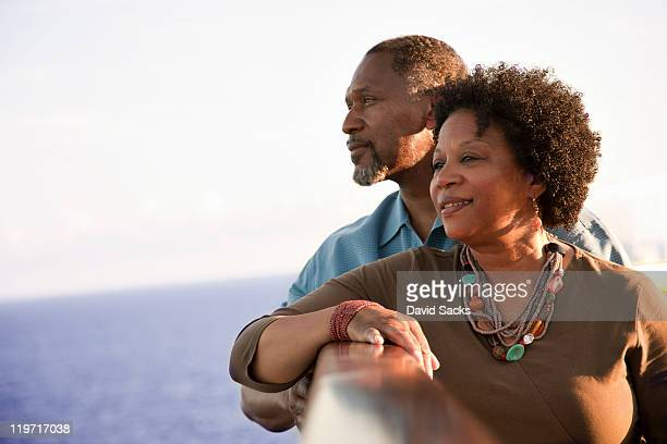 Couple on deck looking into the ocean