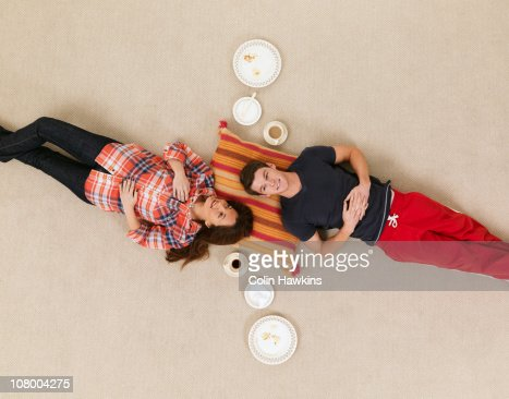 couple on floor with crockery thought bubbles : Stock Photo