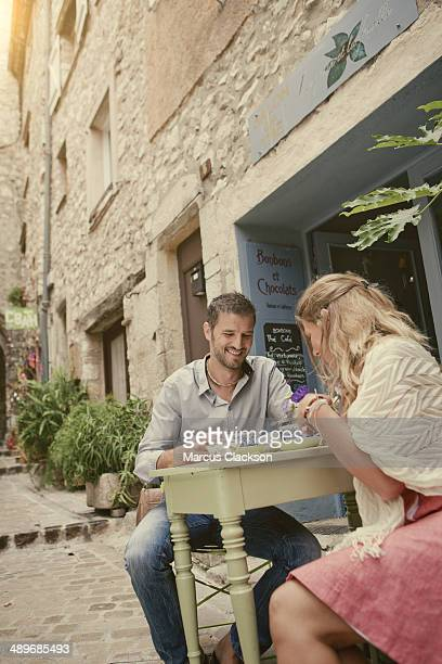 Couple on holiday in France at the cafe