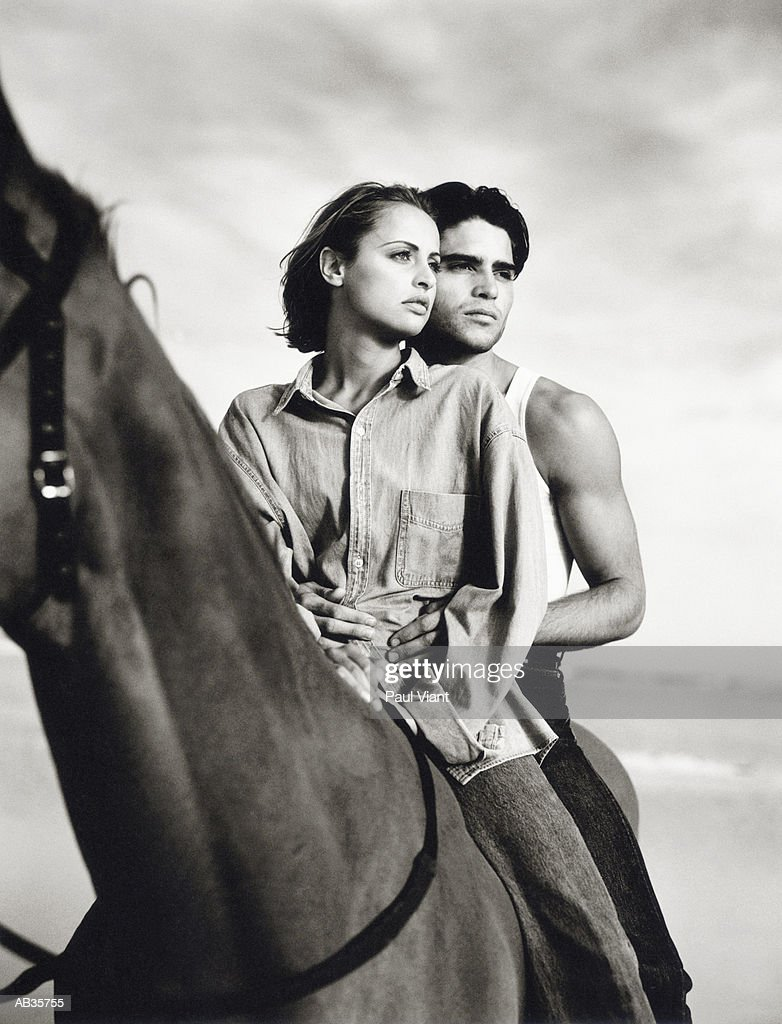 Couple on horse, (B&W) : Stock Photo