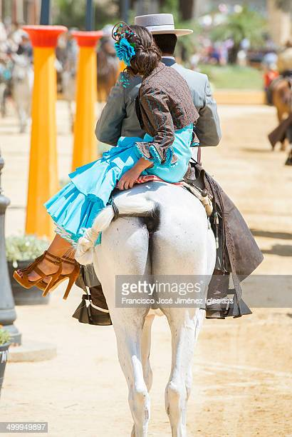 CONTENT] Couple on horseback with typical clothes andalusia during the fair of Jerez de la Frontera