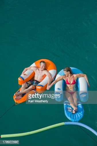 Couple on inflatable float : Stock Photo
