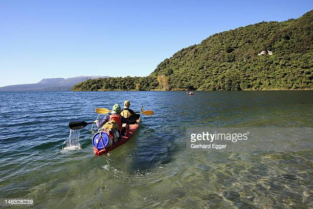 Couple on kayaking expedition, Lake Tarawera