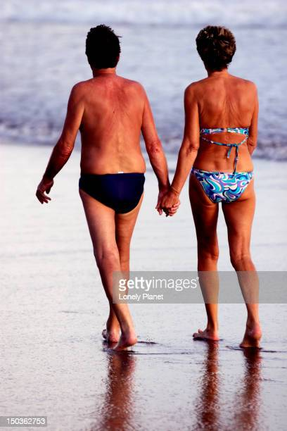 Couple on late afternooon beach stroll.