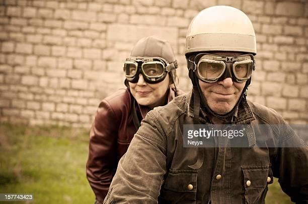 Couple on motorbike, in retro attire