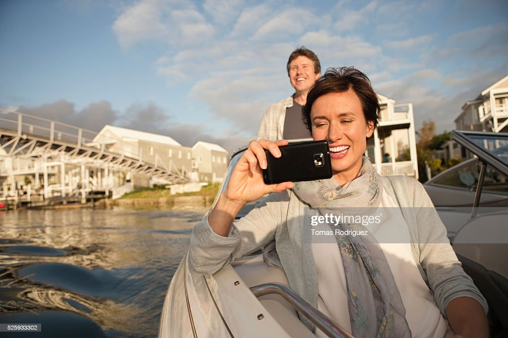 Couple on motorboat : Stock Photo