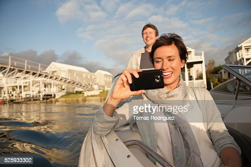 Couple on motorboat : Stock-Foto