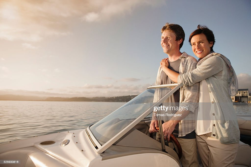 Couple on motorboat : Stock Photo