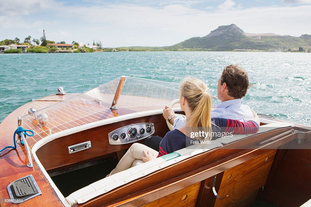 Couple on motorboat trip : Foto de stock