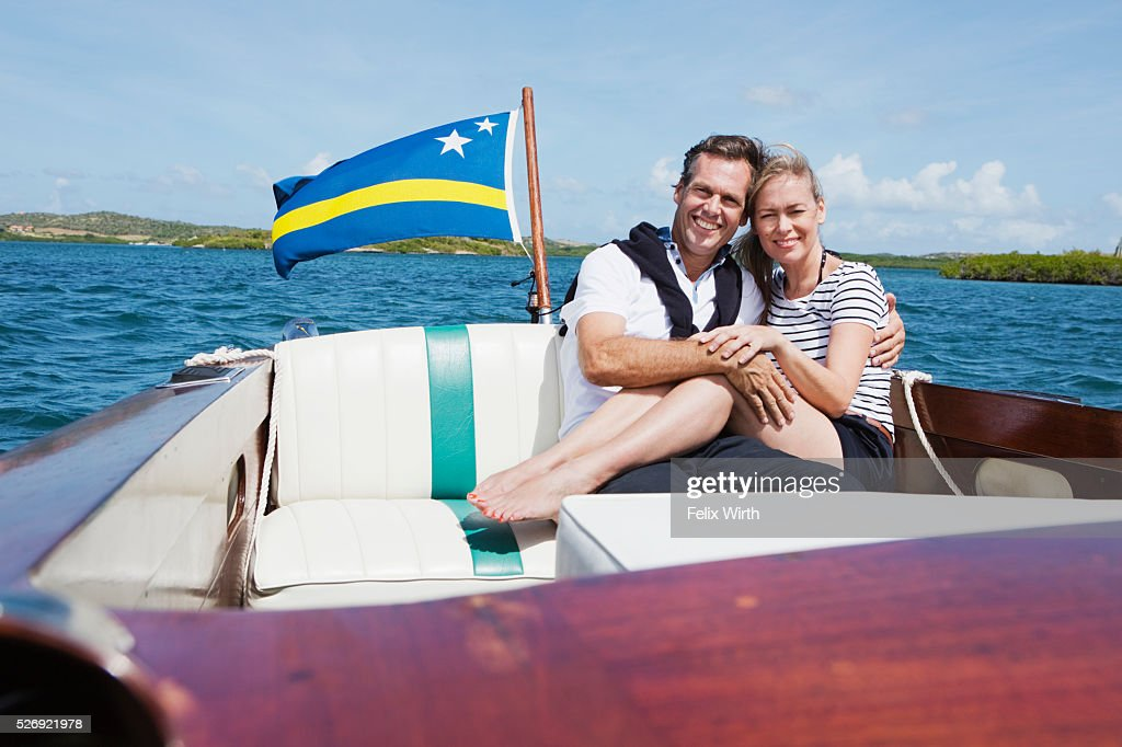 Couple on motorboat trip : Bildbanksbilder