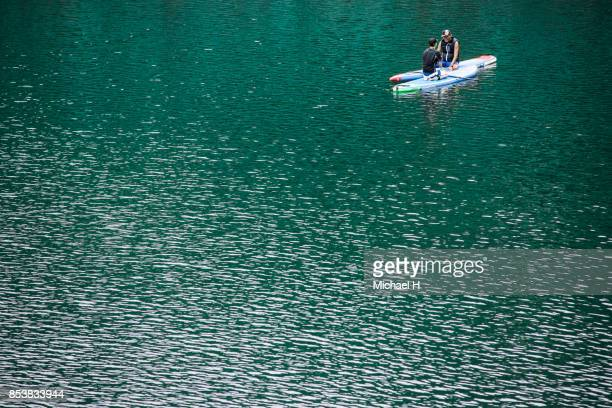 Couple on paddle board in lake