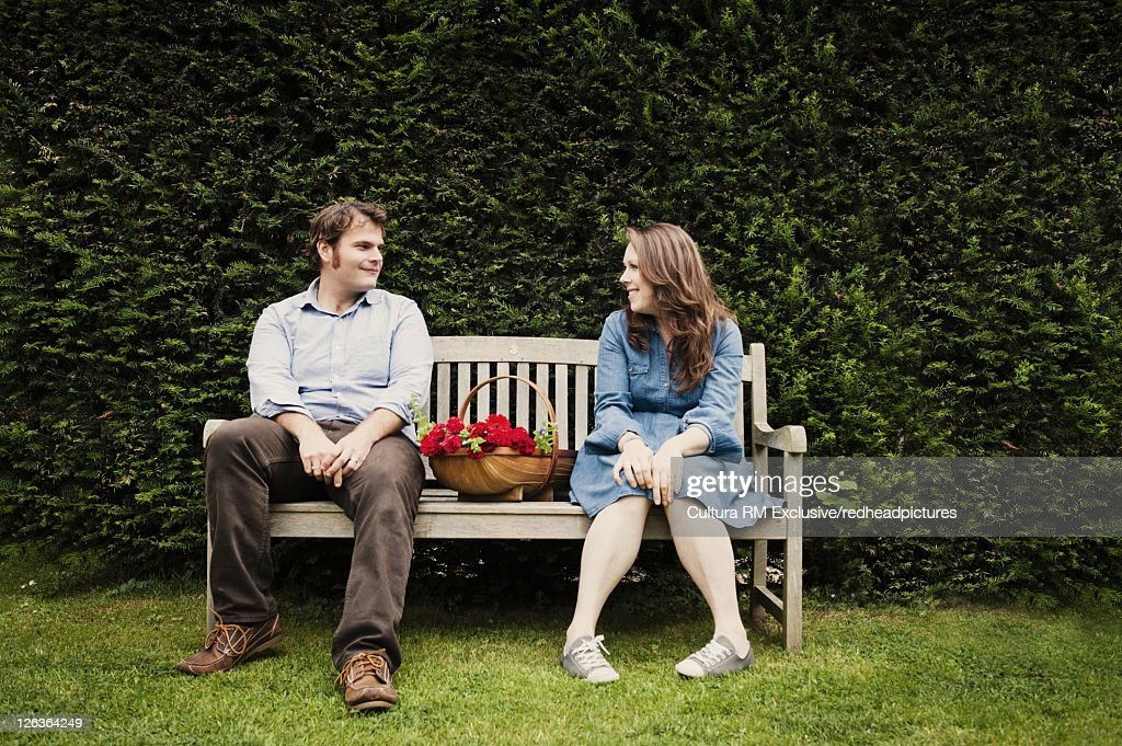 Couple on park bench with flowers