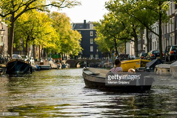 Couple on pleasure cruise through canals