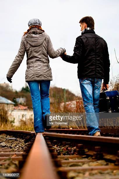Couple on rail track