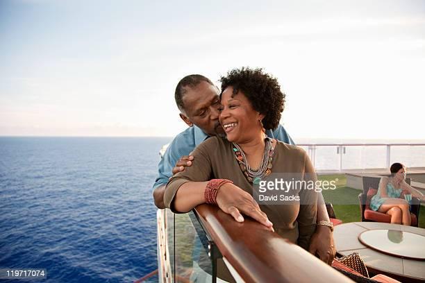 Couple on railing on deck