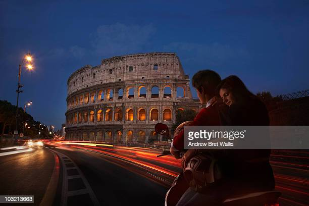couple on scooter near Colosseum, Rome, at night