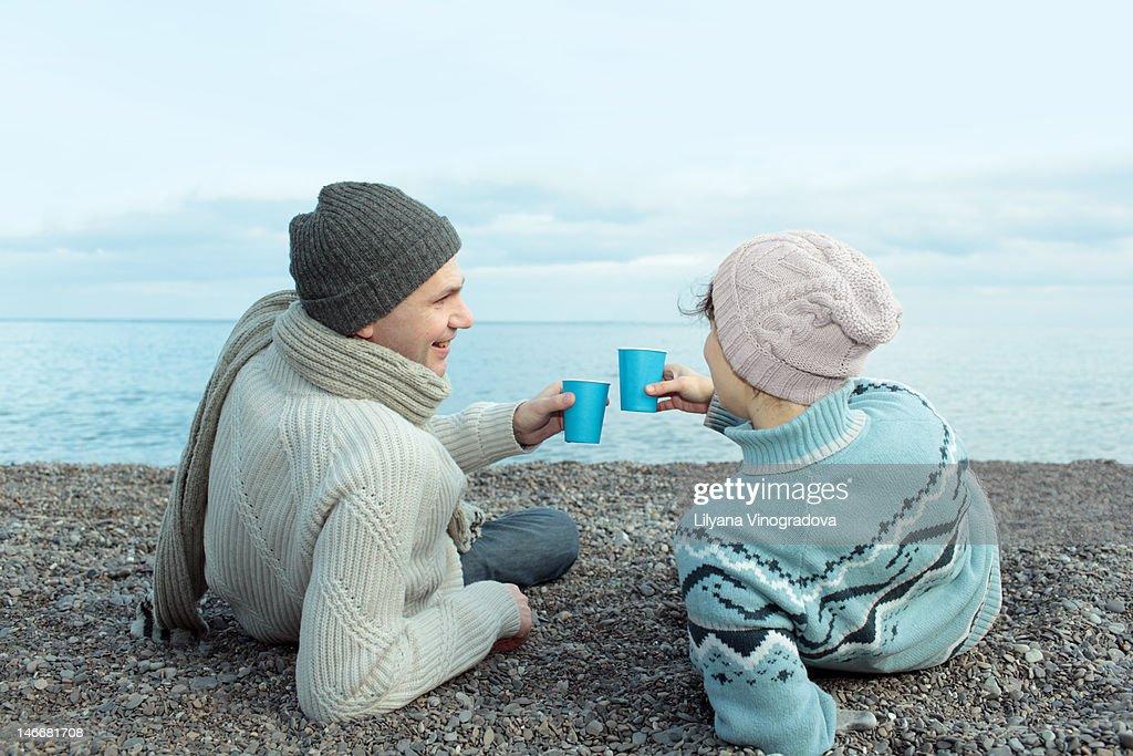 Couple on  sea picnic : Stock Photo