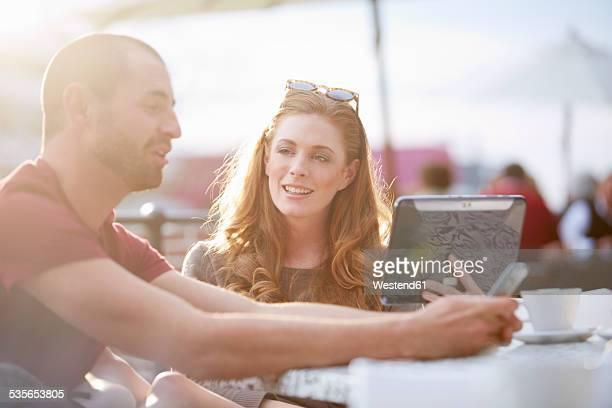 Couple on shopping tour having a coffee break