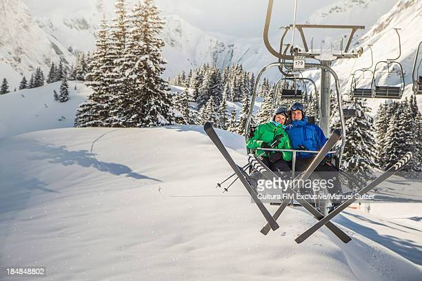 Couple on ski lift, Warth, Vorarlberg, Austria