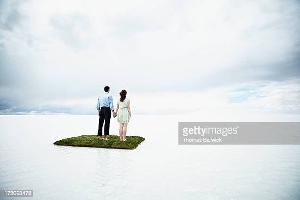 Couple on small island in large body of water