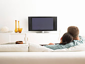 Couple on Sofa Facing TV