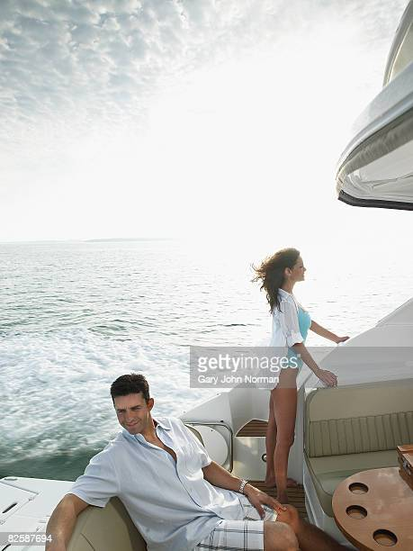 Couple on stern cockpit of powerboat.